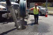 Pumping sewage from manhole in street