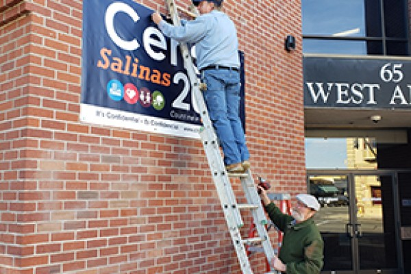 Installing a Census 2020 Banner on 65 W Alisal Street