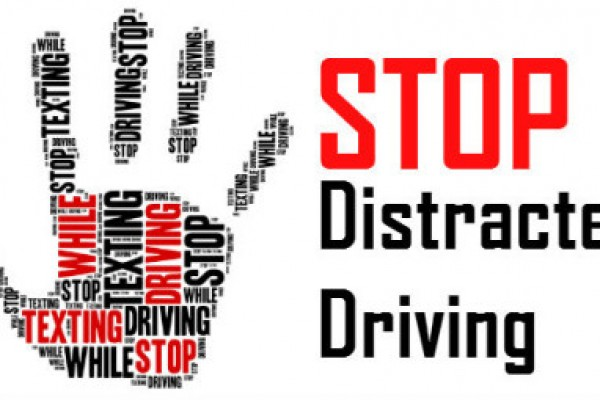 "Hand with repetitve text ""STOP distracted driving"""