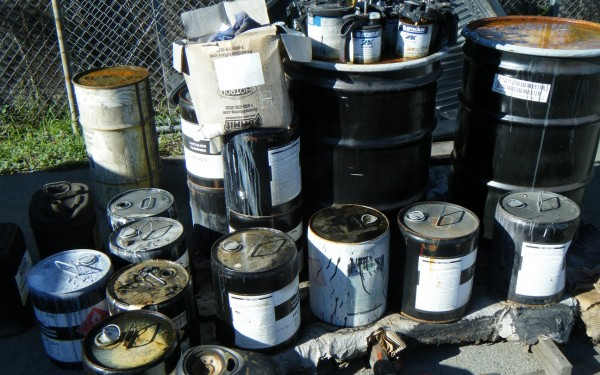old oil cans and bins
