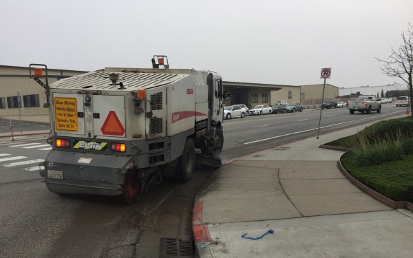 Street Sweeper moving away, around a corner