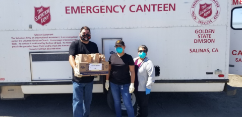 Code Enforcement Staff with Food for Homeless