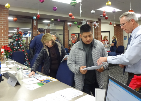 Staff speaks with community members at Permit Center Open House