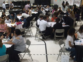 Community working together at small-group discussion tables