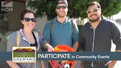 20 something woman and two men showing bucket of collected trash