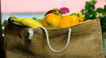 A canvas bag filled with fruit